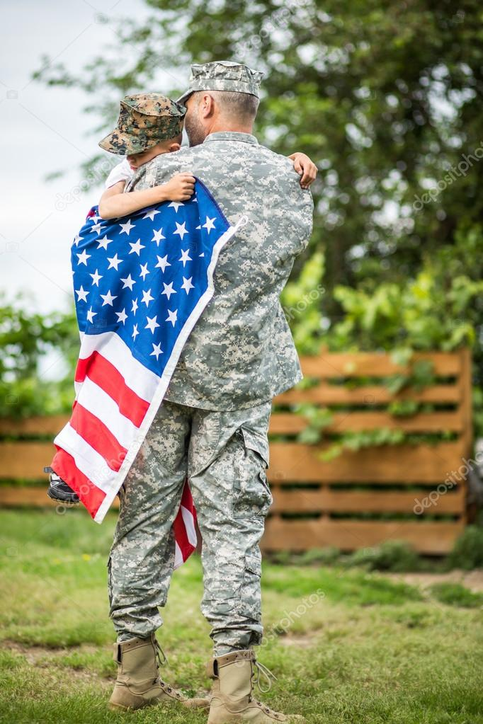 Father hugs his son. American family