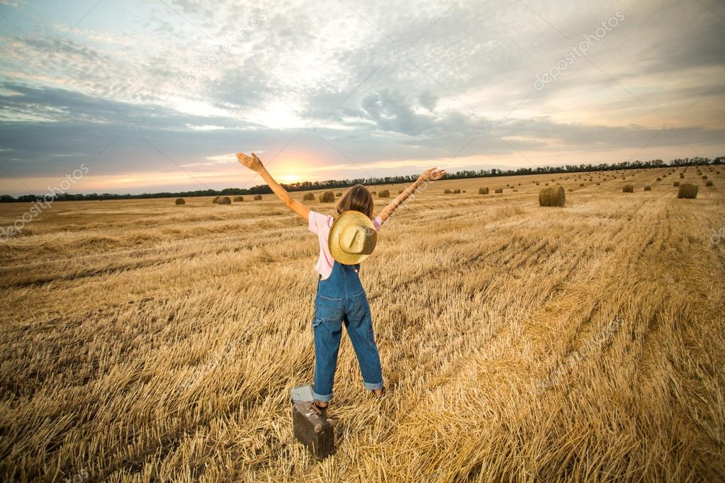 Young girl with hands up to the sky