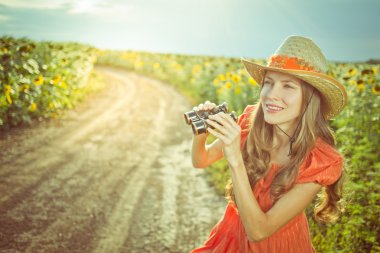 Beautiful young woman traveling on a road