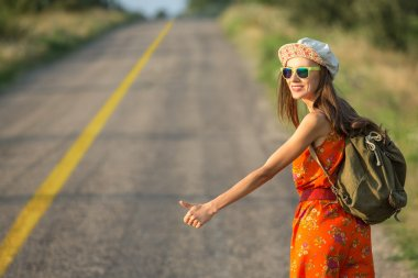 Beautiful young hipster woman traveling