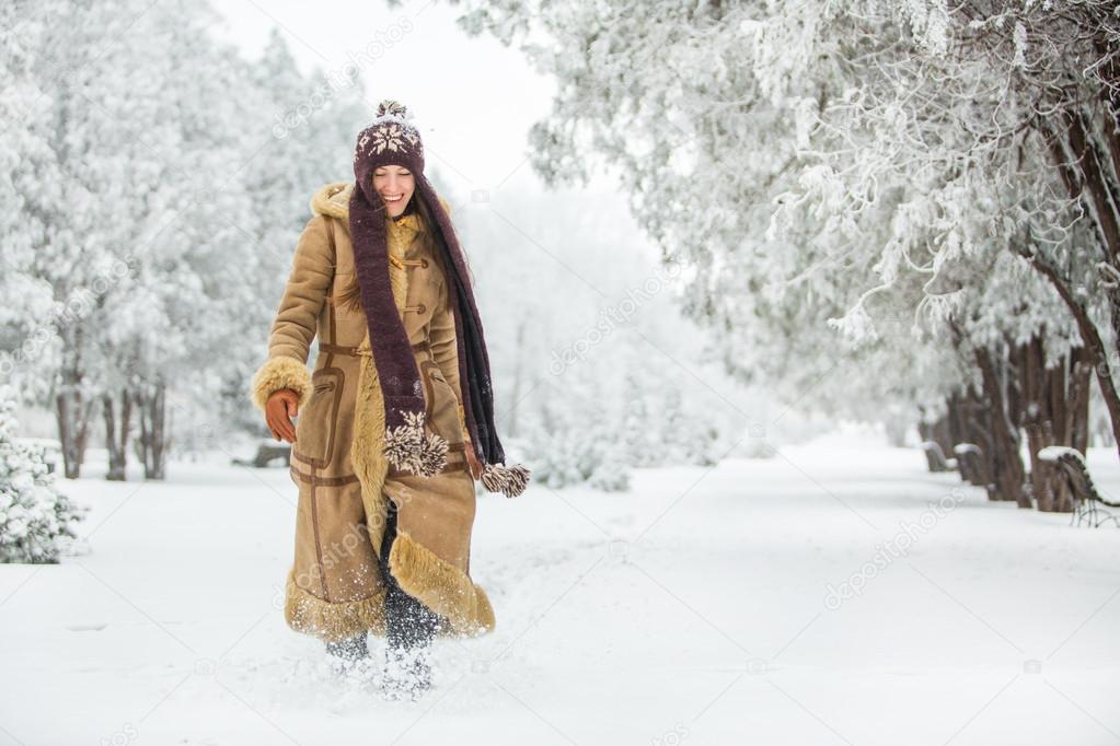 Beautiful winter woman walking