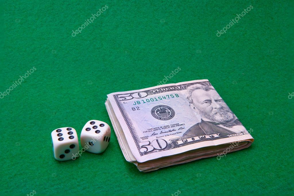 Casino green table with Dollar notes and dice — Stock Photo