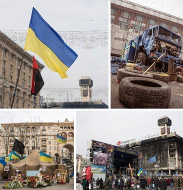 KIEV, UKRAINE - MARCH 7, 2014. Ukrainian revolution, Euromaidan. Days of national mourning for killed defenders of Euromaidan. Flowers and lighted lamps on barricades defenders of Euromaidan