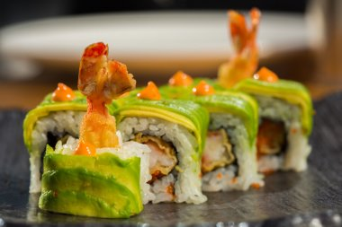 Organic sushi roll with  shrimp tempura at restaurant