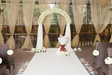 Beautiful wedding arch with roses in the restaurant