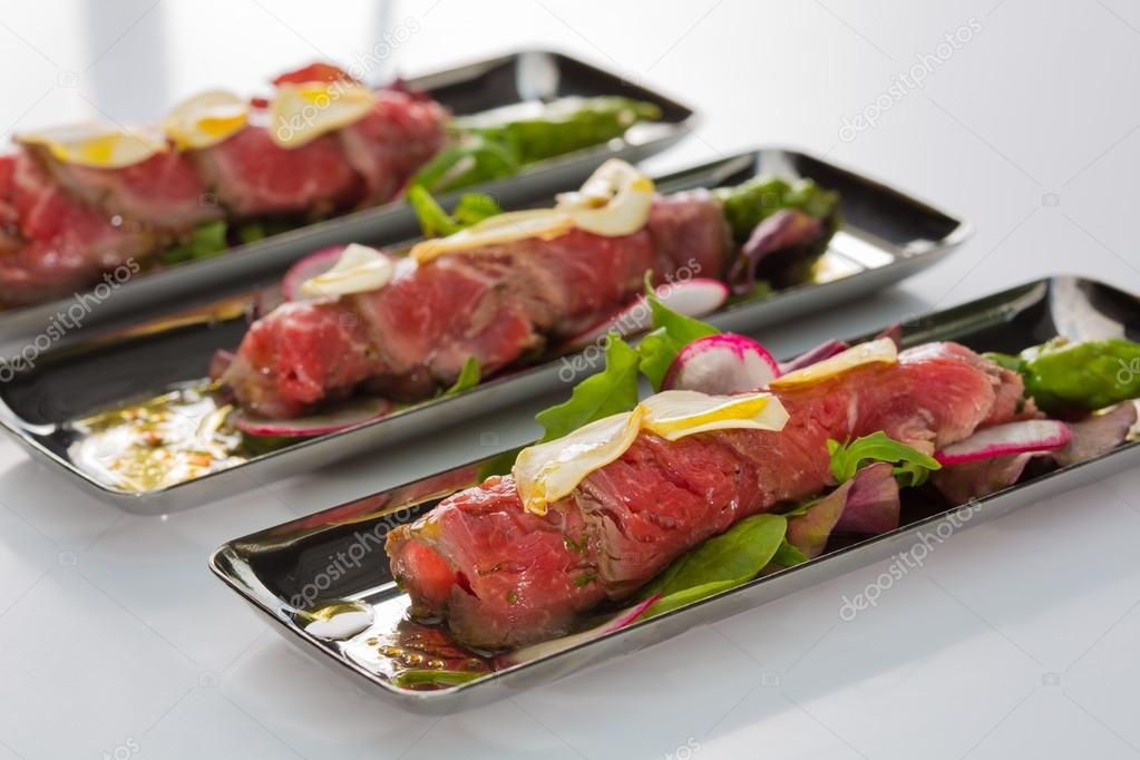 Beef carpaccio with salad leaves and vegetabales  tasty appetize