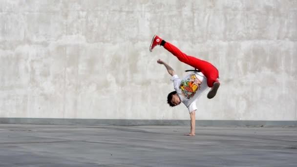 Boy dancing breakdance on the street