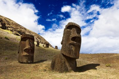 Heads of buried moais standing on a mountain in Easter Island
