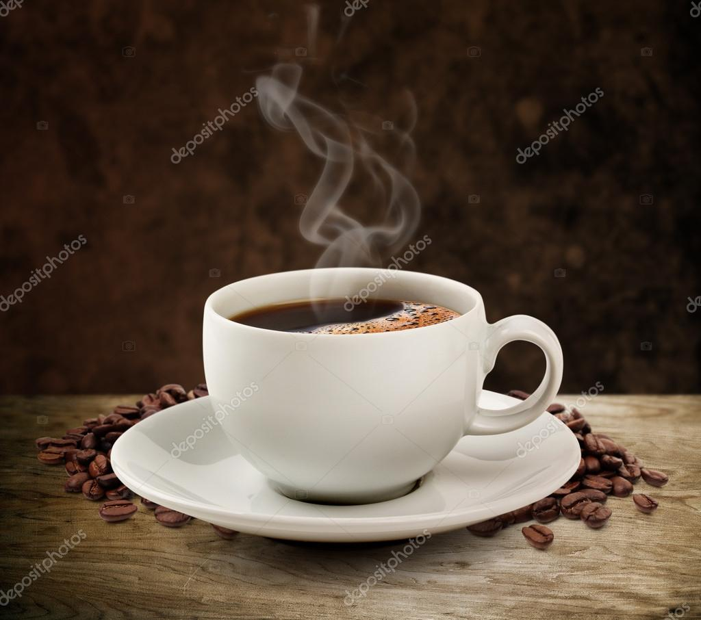 Coffee cup and wooden table dark background (clipping path).