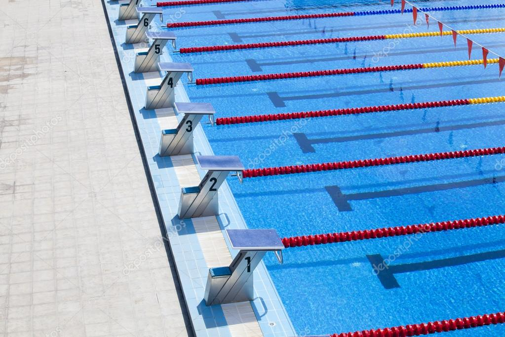 the row of starting blocks of a swimming pool olympic size stock photo - Olympic Swimming Starting Blocks