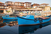 Old wooden fishing boat in port of nessebar,  ancient city on the Black Sea coast of Bulgaria