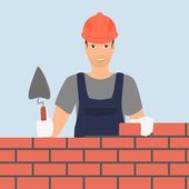 Fotografia generatore uomo sta costruendo un muro di mattoni