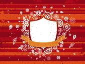 štít, oranžová stuha a dekorativní květiny