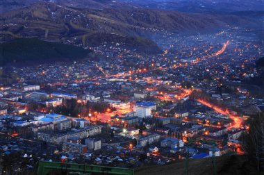 Kind on a city Gorno-Altaisk from a mountain Tugai, in the evening after sunset of a sun.