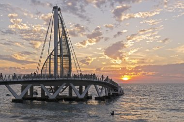Ocean pier in setting sun