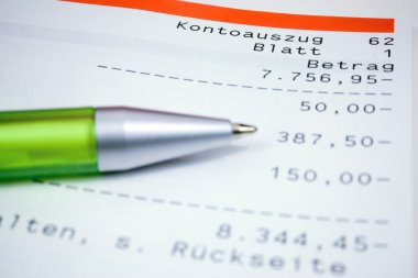 German bank statement with green ball pen