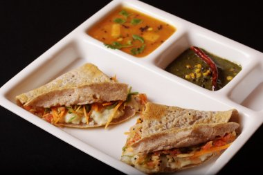 Ragi Dosa is a fermented crepe or pancake made from Ragi batter