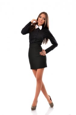 Fashionable young student in black mini dress with white bowtie