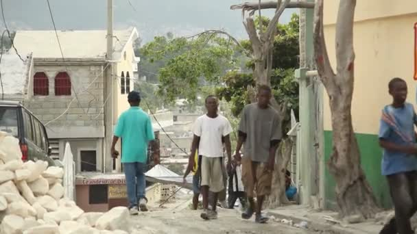PORT AU PRINCE, HAITI - DECEMBER 17, 2013: Unidentified people walking the streets of Port au Prince, Haiti. (For editorial use only.)