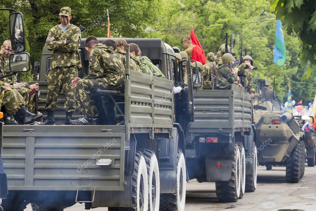 Column of military equipment on parade in honor of the 69th anni