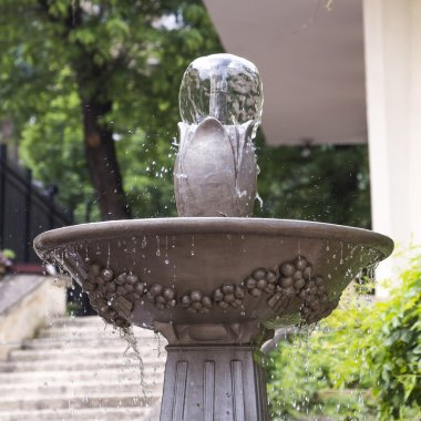 Outdoor stone fountain with a bowl