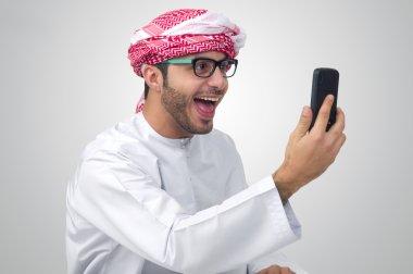 Arab man expressing success
