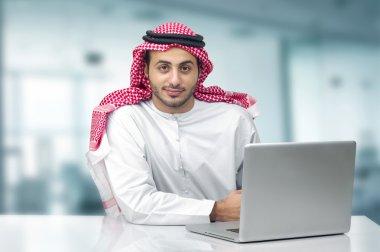 Arabian business man using notebook
