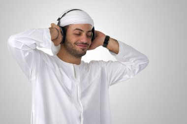 Arabian man listening music