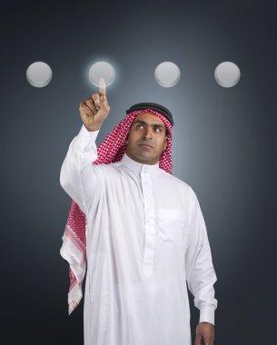 Arabian businessman pressing touchscreen button
