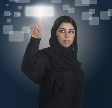 Arabian woman pressing touch screen button