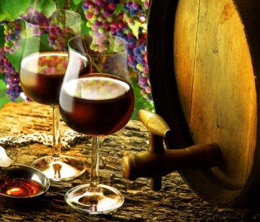 Glasses of red wine in wine cellar