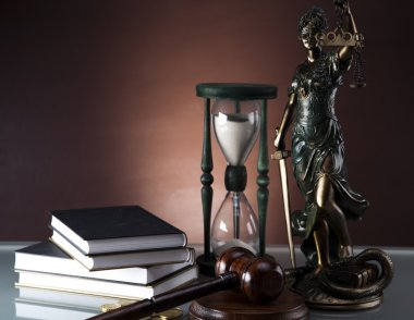 Golden scales of justice, gavel and books ,coins,hourglass