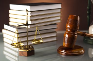 Wooden gavel and book, Statue of Lady Justice, hourglass