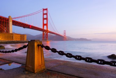 Golden Gate Bridge in San Francisco at sunrise stock vector