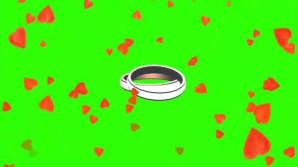 Rotating Wedding Rings Between Falling Hearts Green Screen Stock Video