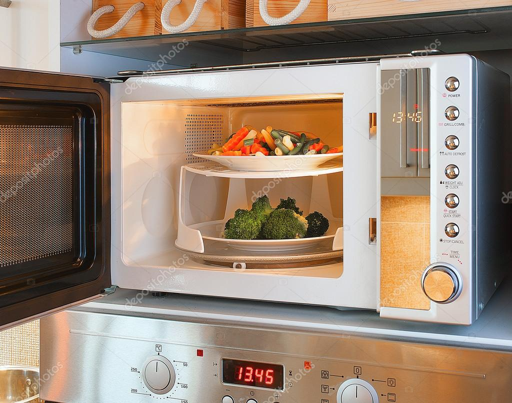 Two Tier Microwave Oven Tray Enables Heating Plates At Once Photo By Grzymkiewicz