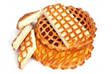 several pies lattice with cheese, jam and lemon on