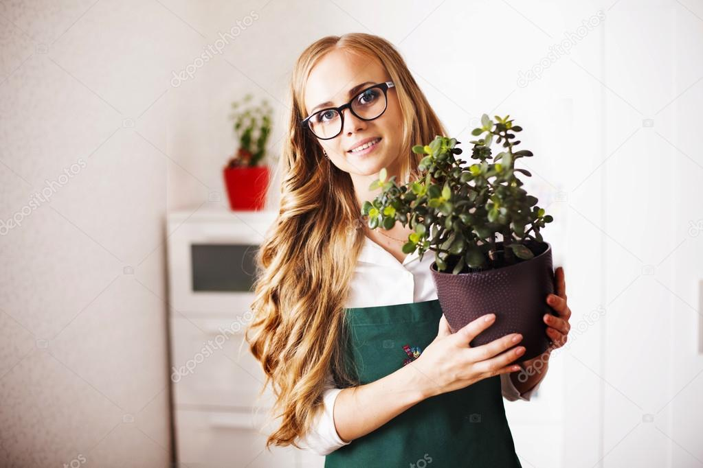 girl with a money Tree is at home