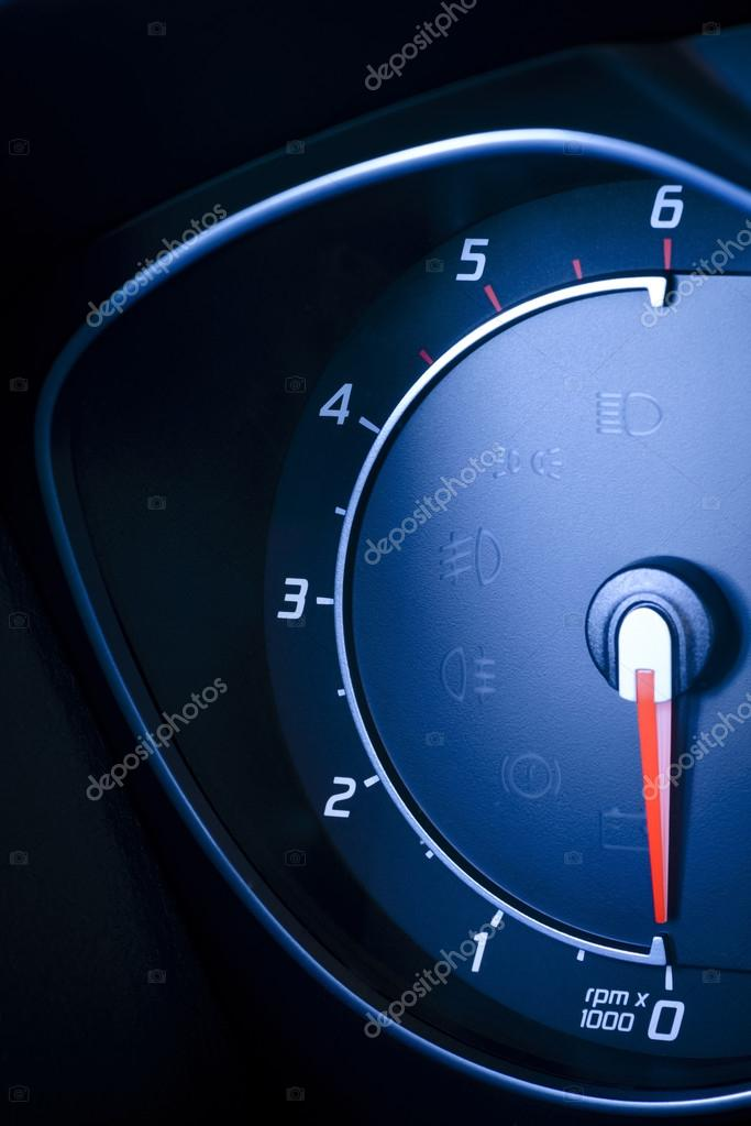 Fragment Of Instrument Panel Of Car Speedometer Tachometer With