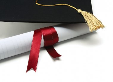 A university diploma with a red ribbon