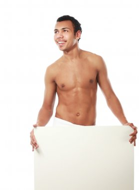 A nude young man covering himself with a towel and standing near blank stock vector