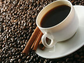 Photo coffee beans with white cup.