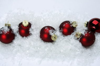 Christmas balls on snow.