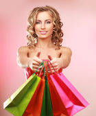 Fotografie Woman holding shopping bags