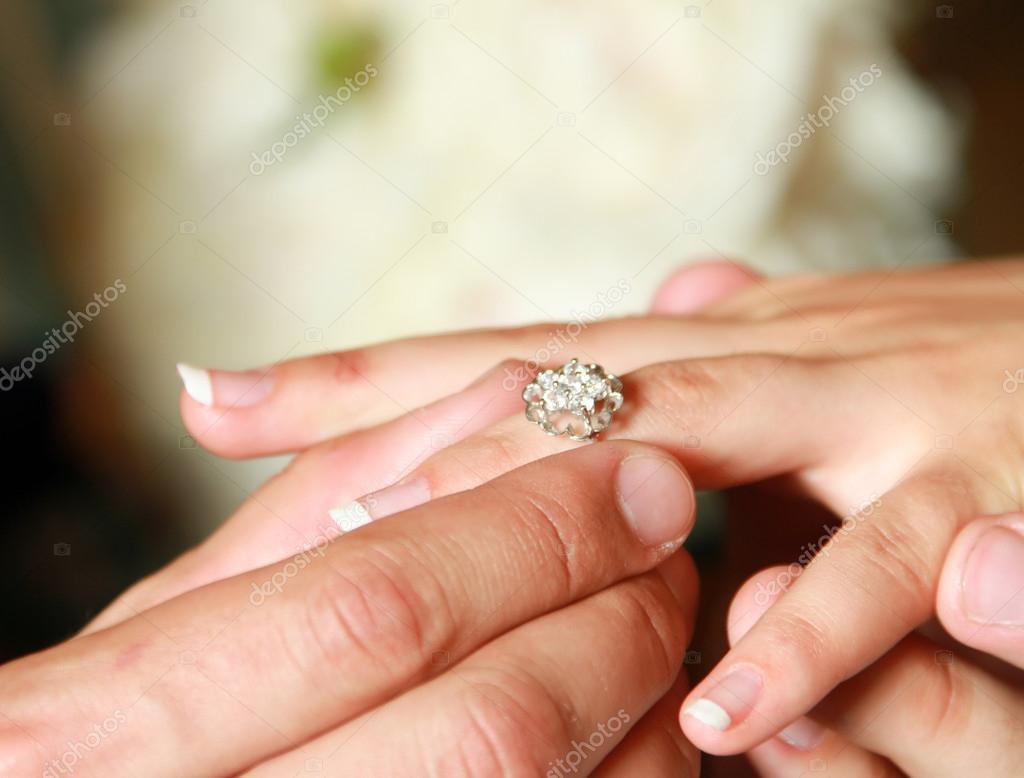 Man Putting Wedding Ring On Woman Hand Stock Photo