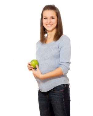 Pregnant woman holding green apple