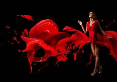 Lady in red. Red dress. Beautiful woman covered in red on a dark background.