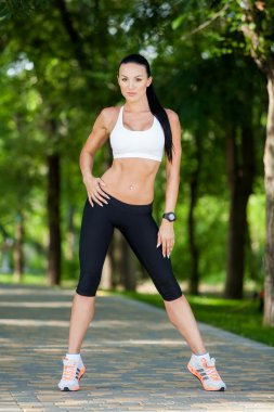Young attractive sport girl  in park