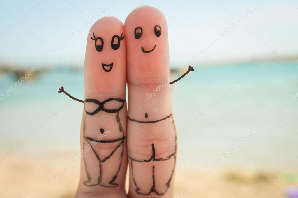 Happy couple. Man and woman have a rest on the beach in bathing suits.