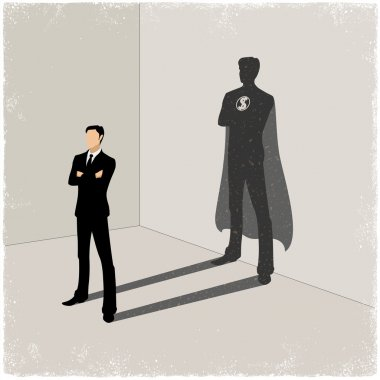 Businessman casting superhero shadow